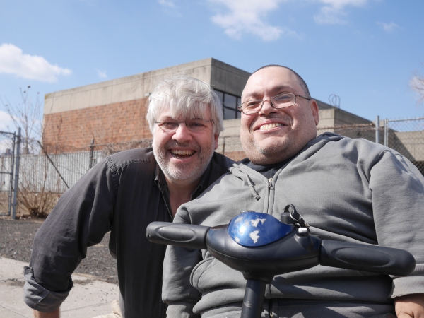 Ed Brady and Ramon Pena (r) outside the shelter on Randall's Island